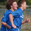 WARREN DILLAWAY / Star Beacon<br /> DAVID ALBERT (left) and Carter Rymarczyk celebrate after a Madison goal Tuesday at Edgewood.