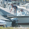 WARREN DILLAWAY / Star Beacon<br /> BOATERS RETURN to Conneaut Harbor after a morning on Lake Erie Thursday.
