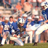WARREN DILLAWAY / Star Beacon<br /> MASON KENSINGER (20) follows through on a kick held by Madison teammate Braden Jerome Friday night during a home game with Lakeview.