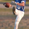 WARREN DILLAWAY / Star Beacon<br /> MASON KENSINGER of Madison kicks off Friday night during a home game with Lakeview.