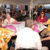 WARREN DILLAWAY / Star Beacon<br /> ALAN CORDELL (right facing at table) and friends enjoy an afternoon at the Wine and Walleye Fest Saturday in Ashtabula.