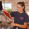 WARREN DILLAWAY / Star Beacon<br /> MARISSA DIAMOND of Laurello Vineyards pours wine during the Wine and Walleye Fest Saturday in Ashtabula.
