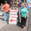 WARREN DILLAWAY / Star Beacon<br /> LIZZ KALIL (far right) and Jeff Taylor (second from right) make the rounds at the Wine and Walleye Fest on Bridge Street in Ashtabula Saturday.
