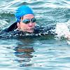 WARREN DILLAWAY / Star Beacon<br /> CHRIS BELL completes her portion of a swim from Geneva-on-the-Lake to Walnut Beach in Ashtabula Saturday. The swim is raising money for the acquatics program at the Ashtabula YMCA.
