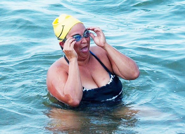 WARREN DILLAWAY / Star Beacon<br /> RHODA WILSON of Windsor, OH, and a teacher at Lakeside, completes her portion of a swim from Geneva-on-the-Lake to Walnut Beach in Ashtabula Saturday. The swim is raising money for the acquatics program at the Ashtabula YMCA.