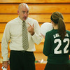 WARREN DILLAWAY / Star Beacon<br /> LAKESIDE VOLLEYBALL coach Norm Potter instructs Lexi David Tuesday evening at Edgewood.