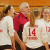 WARREN DILLAWAY / Star Beacon<br /> EDGEWOOD VOLLEYBALL coach Dave Fowler and Warriors Katie Thomas (4), Anna Applebee (14) and Alyssa Johnson (23) enjoy a laught  Tuesday evening during a home match with Lakeside..