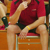 WARREN DILLAWAY / Star Beacon<br /> EDGEWOOD VOLLEYBALL coach Dave Fowler watches the action Tuesday evening at Edgewood.