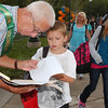 WARREN DILLAWAY / Star Beacon<br /> JOEL PEEL, a volunteer for the Ashtabula Area City Schools, helps a child to the right school Tuesday during the first day of school. The district opened two new intermediate schools on Tuesday.
