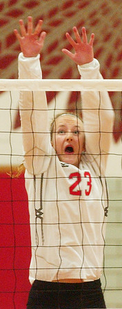 WARREN DILLAWAY / Star Beacon<br /> ALYSSA JOHNSON of Edgewood leaps for a block Tuesday during a home match with Lakeside.