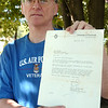 WARREN DILLAWAY / Star Beacon<br /> RON COURSEN of Ashtabula displays a letter he received from Neil Armstrong in April of 1973.