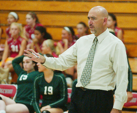 WARREN DILLAWAY / Star Beacon<br /> LAKESIDE VOLLEYBALL coach Norm Potter watches the action Tuesday evening at Edgewood.