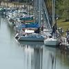 WARREN DILLAWAY / Star Beacon<br /> SAILBOATS ARE reflected in the Ashtabula River Thursday in Ashtabula Harbor.