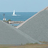 WARREN DILLAWAY / Star Beacon<br /> A SAILBOAT is framed between piles of stone in Ashtabula Harbor Thursday afternoon.