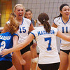 WARREN DILLAWAY / Star Beacon<br /> THE MADISON volleyball team Riley Riehl (13), Hallie Vollmar (2), Ally Klimko (15) Ashley Hixon (7), Haley Hake (11) and Taylor Goudy (far right) celebrate after a point Thursday night at Geneva.