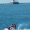 WARREN DILLAWAY / Star Beacon<br /> JET SKIIERS kick up a long line of water while riding just off Lake Shore Park in Ashtabula Township.