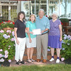 WARREN DILLAWAY / Star Beacon<br /> MARLENE AND Tom Sartini (center) receive the Garden Trails Garden Club garden of the month award from Cindi Licata, GTGC treasurer, (left) and club member Carolyn Vargo (right).