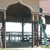 WARREN DILLAWAY / Star Beacon<br /> CAL WHITTINGEN of Ashtabula Vinyl works on the lower pavilion at Lake Shore Park in Ashtabula Township Monday.