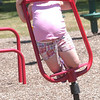 WARREN DILLAWAY / Star Beacon<br /> HANNAH DEPUE, 6, of Geneva, plays at Little Peoples Park on North Eagle Street in Geneva Monday afternoon.