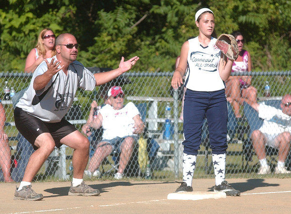WARREN DILLAWAY / Star Beacon<br /> MIKE PUCEL, assistant coach for Grand Valley, gestures to a base runner as Conneaut's Lexi Campbell waits for the ball during 11 and 12 year old all star action at Skippon Park in Conneaut Monday evening.