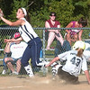 WARREN DILLAWAY / Star Beacon<br /> LEXI CAMPBELL (left) of Conneaut waits for the ball as Grand Valley's Leah Patterson slides safely into third during 11 and 12 All Star action at Skippon Park Monday evening.
