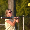 WARREN DILLAWAY / Star Beacon<br /> JULIE CROSSLEY of Jefferson United Methodist Church swings Tuesday evening during church league action at Massucci Field in Ashtabula.