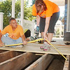 WARREN DILLAWAY / Star Beacon<br /> DANA QUINN (left) of Conneaut and Julie Joseph of Lawrenceville, Ga., build a new porch on a home along Main Street in Conneaut. The Loving Equally All Familes program gathered about 40 workers to help families throughout the Conneaut area.