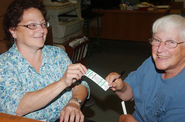 WARREN DILLAWAY / Star Beacon<br /> BETH COOL (left) and Kathy Murray display a ticket for the Ashtabula County Fair performance of Jake Owen. The tickets went on sale Tuesday morning at the fair office in the grandstand at the fairgrounds in Jefferson.