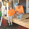 WARREN DILLAWAY / Star Beacon<br /> DANA QUINN (right) of Conneaut and Samantha Lynch, 14, also of Conneaut, build a new porch on a home along Main Street in Conneaut. The Loving Equally All Familes program gathered about 40 workers to help families throughout the Conneaut area.