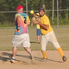 WARREN DILLAWAY / Star Beacon<br /> COOPER MCMANNES (right) of the Jefferson United Methodist Church forces Chuck Stevenson at second base before firing to first Tuesday during church league softball action at Massucci Field in Ashtabula.