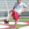 WARREN DILLAWAY / Star Beacon<br /> BRENT COTTON, a seventh grader at Jefferson Junior High, participates in a punt competition Thursday during a football camp at Jefferson High School.