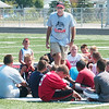 WARREN DILLAWAY / Star Beacon<br /> JIM HENSON, head football coach at Jefferson, talks with participants in the Jefferson football camp Thursday at Jefferson High School.