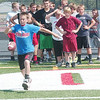 WARREN DILLAWAY / Star Beacon<br /> CADEN CICON, a seventh grader at Jefferson Junior High, participates in a punt competition Thursday during a football camp at Jefferson High School.