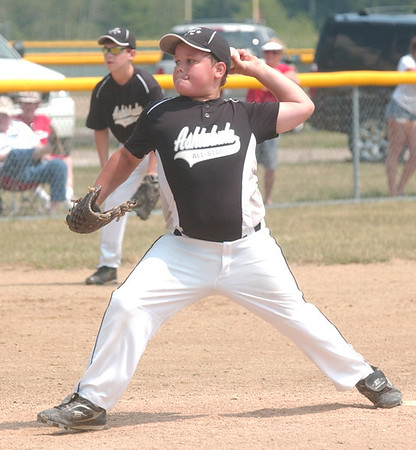 WARREN DILLAWAY / Star Beacon<br /> JACOB BRYANT pitches for the Ashtabula 11 and 12 All Stars Sunday during a District 1 championship game wiith Jefferson at Havens Complex in Jefferson.