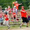 WARREN DILLAWAY / Star Beacon<br /> BRIAN MEHALIC, third base coach for the 9 and 10 All Stars, celebrates during a District 1 game against Geneva United at Tickner Field in Austinburg Township.