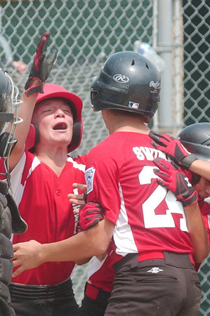 WARREN DILLAWAY / Star Beacon<br /> ROBERT NIEMI (left) of the Jefferson 11 and 12 All Stars greets Mason Swiney after Swiney hit a home run Sunday during a District 1 championship game with Ashtabula at Havens Complex in Jefferson Township.