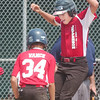 WARREN DILLAWAY / Star Beacon<br /> MASON SWINEY (right) of the Jefferson 11 and 12 All Stars leaps on to homeplate after hitting a home run during a District 1 championship game with Ashtabula Sunday at Havens Complex in Jefferson Township.