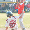 WARREN DILLAWAY / Star Beacon<br /> ALEX TULINO of Ashtabula forces Charlie Hughes at second base during a District 1 9 and 10 year old All Star game at Carraher field in Geneva Monday evening.