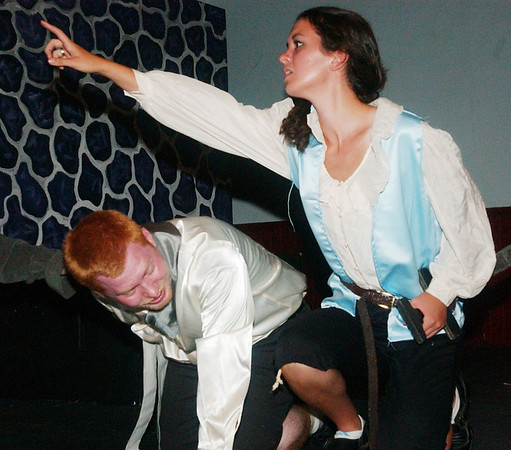 WARREN DILLAWAY / Star Beacon<br /> DAVID STOUFFER (left), Mercutio, doubles over in pain after being stabbed as Sarah Fetsko, asks for help during Romeo and Juliet at the Harbor Playhouse Theatrical Co-op.
