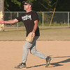 WARREN DILLAWAY / Star Beacon<br /> DAVE BETCHER of Intimidation Furniture Towne casts a long shadow while pitching Monday night during Ashtabula Rec League softall at Massucci Field in Ashtabula.