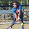 WARREN DILLAWAY / Star Beacon<br /> DERRELL MCCALEB of the East Ashtabula Club goes low but comes up with a hit Monday during Ashtabula Rec League softball at Massucci Field in Ashtabula.