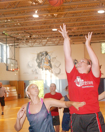 WARREN DILLAWAY / Star Beacon<br /> CORTNEY HUMPHREY of Edgewood shoots Tuesday evening as Conneaut's Dani Heinonen (lower left) watches Tuesday during summer league girls basketball action at Mahoney Gymnasium in Ashtabula.
