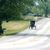WARREN DILLAWAY / Star Beacon<br /> AN AMISH buggy drives down Route 7 in Monroe Township Tuesday afternoon.