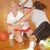 WARREN DILLAWAY / Star Beacon<br /> KATE BROOKS of Edgewood and  Rae Ann Benedict of SS. John and Paul wrestle for the ball Tuesday during summer league girls basketball action at Mahoney Gymnasium in Ashtabula.
