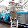 WARREN DILLAWAY / Star Beacon<br /> PETE HEADLEY a supervisor with Sam's Amusements works on a ride Wednesday in preparation for the Conneaut Fourth of July Festival which starts later today.