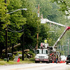 WARREN DILLAWAY / Star Beacon<br /> ILLUMINATING COMPANY crews repair power lines damaged Tuesday night when severe storms hit Lake Road in Conneaut.