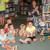 WARREN DILLAWAY / Star Beacon<br /> CHILDREN APPLAUD Kelly Miller Circus advance clowns during a presentation Thursday afternoon at the Rock Creek Library. The circus will perform 2 p.m. and 5:30 p.m. July 21 on East Water Street at the VFW Post 4953 grounds.