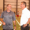 WARREN DILLAWAY / Star Beacon<br /> CHILDHOOD FRIENDS Dean Hood (left), head football coach at Eastern Kentucky University and Urban Meyer, head football coach at Ohio State University, enjoy a laugh Thursday during a football camp they helped organize at SPIRE Institute in Harpersfield Township.