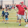 WARREN DILLAWAY / Star Beacon<br /> BILL LIPPS, an assistant football coach at Edgewood High School, instructs students during a football camp at SPIRE Institute in Harpersfield Township.