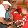 WARREN DILLAWAY / Star Beacon<br /> LOGAN QUEEN (7) receives instruction from Jim Elmore, an assistant football coach at Lakeside, during a free football camp sponsored by Ashtbula County natives Dean Hood, presently head football coach at Eastern Kentucky University, and Urban Meyer, presently head football coach at Ohio State University.